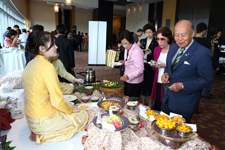 Past District Governor Gen. Saiyud Kerdpol stops to taste the delicious Thai sweets on display.