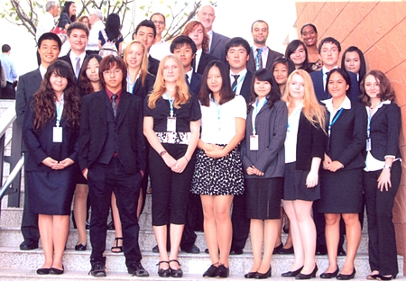 Students and delegates pose for a group photo at the Model United Nations Conference, Bangkok.