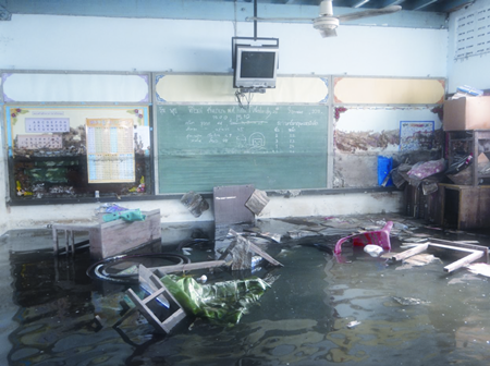 Inside a classroom once the floods started subsiding, but the high water mark can still be seen on the blackgboard.