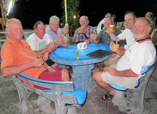 "The anglers enjoy a beer while swapping stories of the ones that ""got away""."