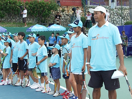 Withaya Samrej (right) conducts the tennis clinic at the Dusit Thani hotel, Pattaya, Saturday, Feb. 11.