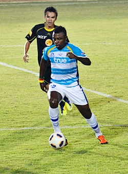 Pattaya United's Cameroon import Paul Ekollo (32) is seen in action in a Thai Premier League fixture against Army United last season.