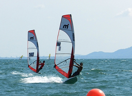 Indonesia's Oscar Sulaksana (right) leads Thailand's Navin Singhsat in the Mistral One Design Asia Championship.