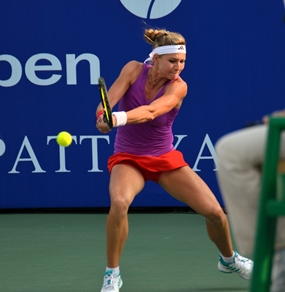 Maria Kirilenko hits a return on her way to winning the first set tie-break.