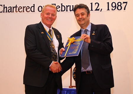 President Mark Butters (RCBS) presents a 50th anniversary commemorative book to President Gudmund Eiksund.