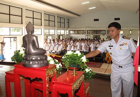 Adm. Somchai Na Bangchang, deputy commander of ACDC, leads more than 300 soldiers to perform Buddhist religious rites.