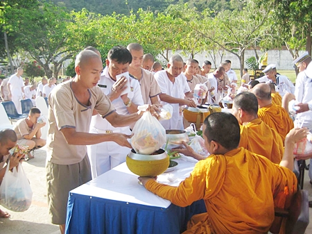 Prisoners at Sattahip Prison offer alms to monks and observe the 8 day religious precepts.