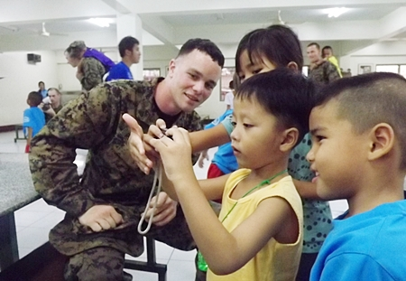 The children at Pattaya Orphanage certainly enjoy play time with US soldiers.