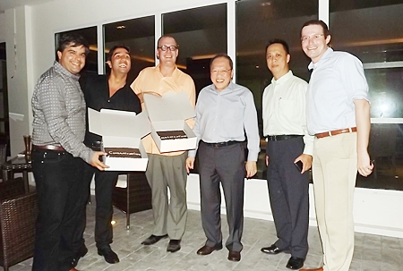 Friends congratulate Austin Robinson with 'double whopper' cakes on the opening of the Centara Pattaya Hotel.