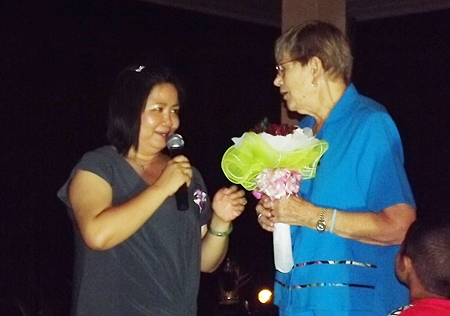 Nancy Bendburn presents a bouquet to Piangta Chumnoi, the benevolent director of Ban Jing Jai Foundation.