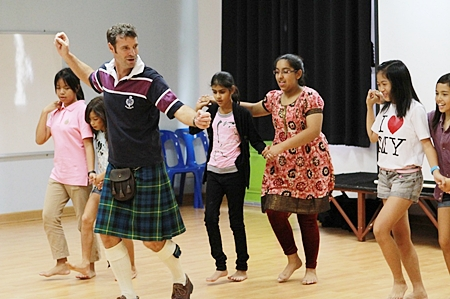In the morning activity, Mr. Andrew Gordon teaches Scottish dance to the students.