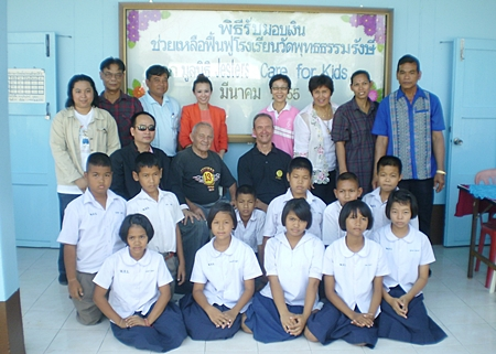 The group, which includes the principal, faculty, Pattaya YWCA, Police Academy members, students and us.