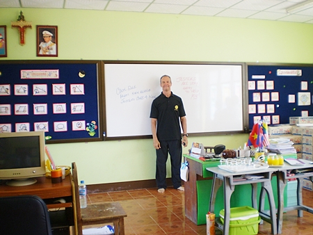Woody stands in front of the whiteboard in one of the new classrooms.