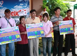 Ministry of Transport officials present vouchers for prosthetic limbs to handicap victims of road accidents.