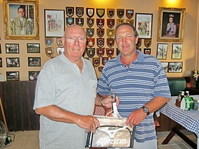 Max (left) presents the MBMG Golfer of the Month award to Rob Brown.
