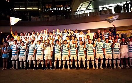 The Pattaya United playing squad pose for a team photo at Central Beach Pattaya shopping mall, Sunday, March 4.