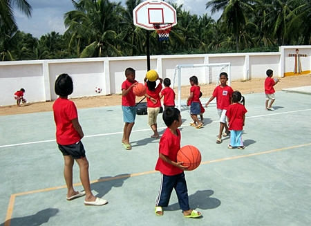 The children at the center make good use of the new sporting equipment.