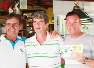 John Cogan (centre) with Tuesday's scramble winners Dennis (left) & Martin (right).