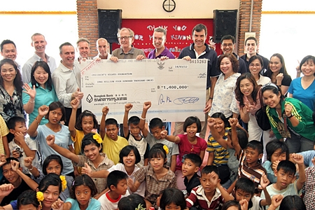 "Karl Morsbach (6th left), Chairman and Founder of Baan Gerda Project recently received a donation cheque for 1.4 million baht from Pierre Andre Pelletier (3rd left), GM of the Amari Watergate Bangkok and Matthias Pfalz (8th left), President of BMW (Thailand) Co., Ltd. The Funds were part of the 3.3 million baht raised from ""The 14th Amari Watergate & BMW Group Thailand Midnight Run"" and ""The 15th Aerobic Marathon on AIDS"" to support the HIV orphanage in Lopburi Province. The 1.4 million baht will be donated through HRH Princess Maha Chakri Sirindhorn to support the Chalerm Prakiat School in Lumpoon province and the other 500,000 baht already donated to support Baht for a Better Life Project."