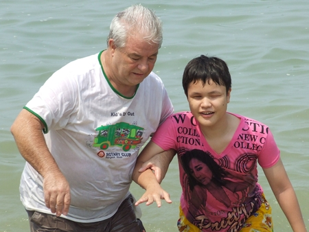 Helping a young blind woman experience the warm waters of the Gulf of Thailand for the very first time.