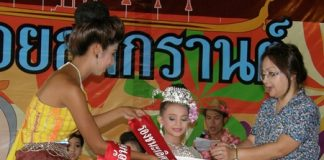 Chanissara Katie Marsh receives her sash and envelope from the emcee, for being placed 'after second'.