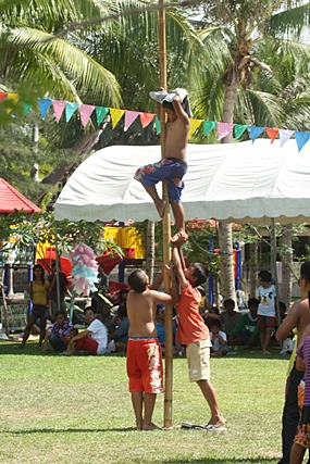 Some of the youngsters become extra resourceful, trying to reach the 500 baht at the top of the greased pole.