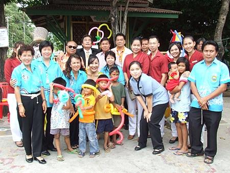Local officials and benevolent citizens make merit at the Baan Phra Khun Child Development Center.