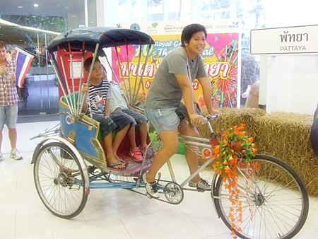 Hey kids, this is what a rickshaw is.  You don't see many around nowadays.