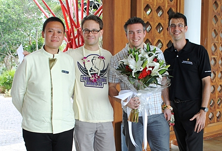 (Left to right) Nakaret Butthuam, Head Butler, Colin Baugart, Mathias Urbaczek (the resort's first guest) and Arnaud Girodon, General Manager.