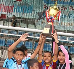 The Father Ray Children's Home team celebrate their win.