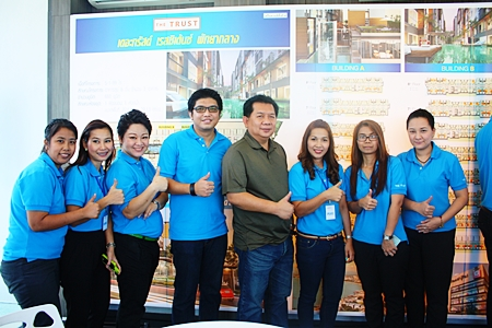 Pairoj Wattanarodome, MD of The Confidence (5th from left) poses for a photo with the sales staff of The Trust Residence Central Pattaya.