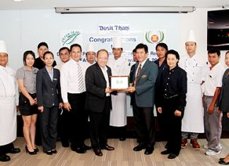 Chatchawal Supachayanont (centre left), GM of the Dusit Thani Pattaya and members of the hotel's Green Team proudly receive the ASEAN Green Hotel Standard 2012-2014 from Dr Jiraphol Sinthunava, vice-president of the Green Leaf Foundation. Dusit Thani Pattaya has maintained its eco-friendly status since it embraced the green initiatives more than ten years ago. This has resulted in their receiving many awards from various environmental organizations recognizing the work of the resort's Green Team committee under the management and supervision of Chatchawal Supachayanont.