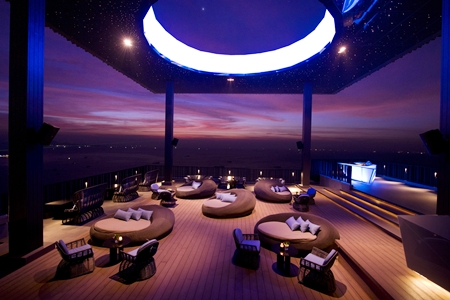 "The roof-top covering features the ""hole in the ozone layer"" through which the guests can see the moon."