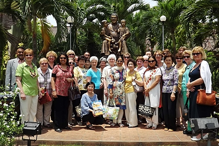 Everyone gathers for a photograph in front of Father Ray's statue, the beloved father and founder of the Pattaya Orphanage.
