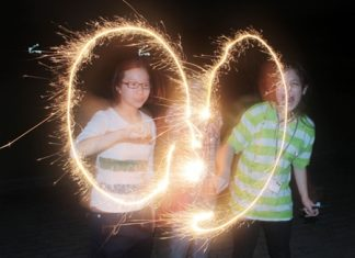 Campers making shapes with sparklers during the evening activity.