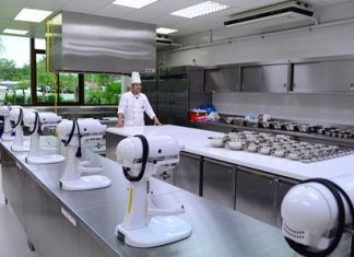 A school chef prepares to show off the cooking demonstration room.