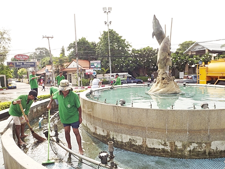 A clean up crew from Pattaya Public Works gives the Dolphin Roundabout a good scrubbing, healing a long-standing eyesore.