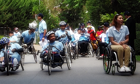 Wheelchair marathon riders are anxious to get underway at the release of the caravan towards Nong Khai.