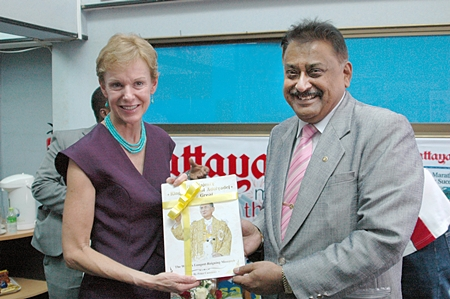Pattaya Mai MD Peter Malhotra (right) presents a copy our book about HM the King's birthday to HE Kristie Kenney, U.S. Ambassador to Thailand.