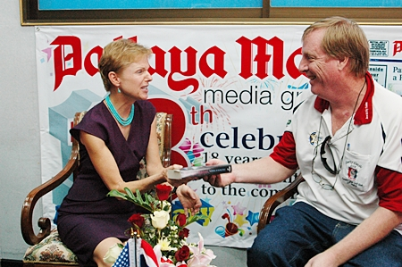 Dan Dorothy presents the ambassador with a signed copy of his novel, Mango Rains.