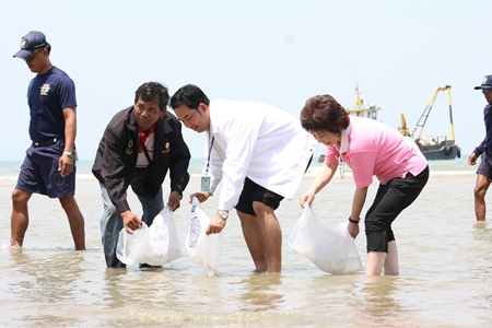 Mayor Itthiphol Kunplome and city officials symbolically release fish and shrimp to generate interest in the project to restore the area's natural resources.
