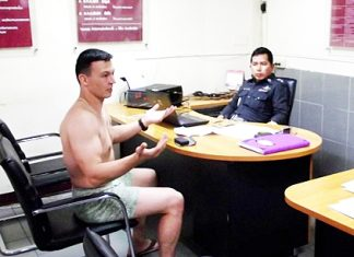 Ruslan Hamitovieh explains to police how his clothes were stolen.