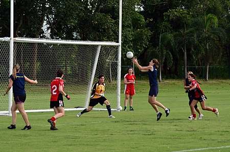 Thailand on the attack against Singapore B in the ladies Plate final.