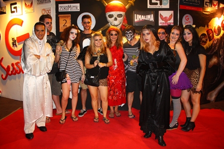 """Ghosts and ghouls assemble for the """"VooDoo G Session"""" Beach Party."""