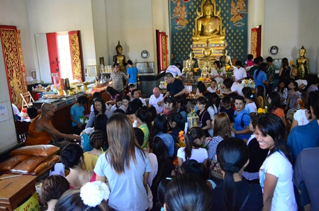 Buddhists gather at Wat Chaiyamongkol in South Pattaya to present Sangkhathan (necessary items for monks) and make merit on Visakha Bucha Day.