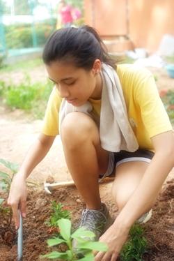 Mae working in the butterfly garden.