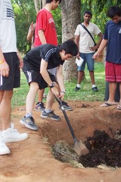 Students digging compost.