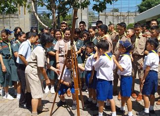 Students in Sattahip gather to watch Venus transit the sun.