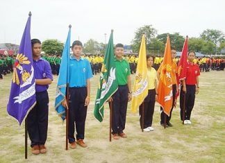 "It's flag day at Singsamut School when students receive their colored ""flags of unity""."