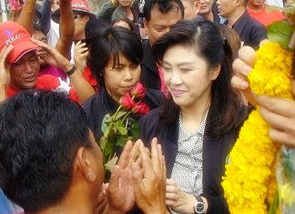 Prime Minister Yingluck Shinawatra is greeted by adoring followers as she arrives for the Kingdom's 5th Mobile Cabinet Meeting held here in Pattaya June 18-19.